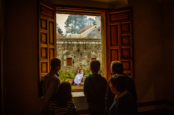 creative wedding portrait of family looking through window at bride and groom, photo by David Josue - Mexico | via junebugweddings.com