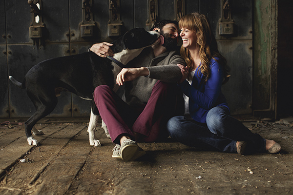 kissing engagement photo with dog by Amy Karp Photography | via junebugweddings.com