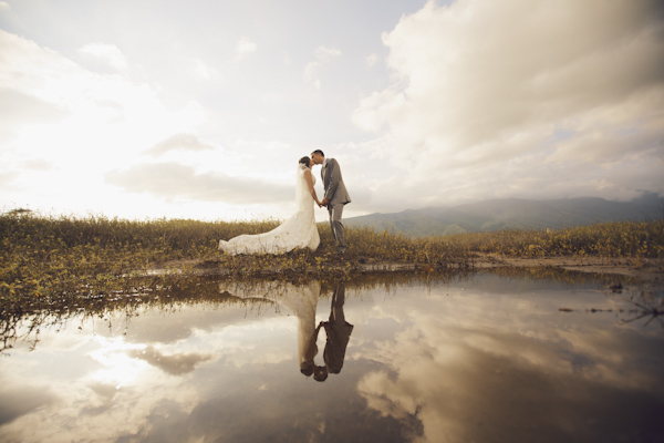 kissing wedding photo with reflections in water by Anna Kim | via junebugweddings.com