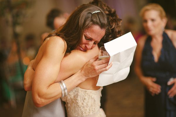 emotional embrace at wedding reception, photo by Ryan Brenizer - New York | via junebugweddings.com