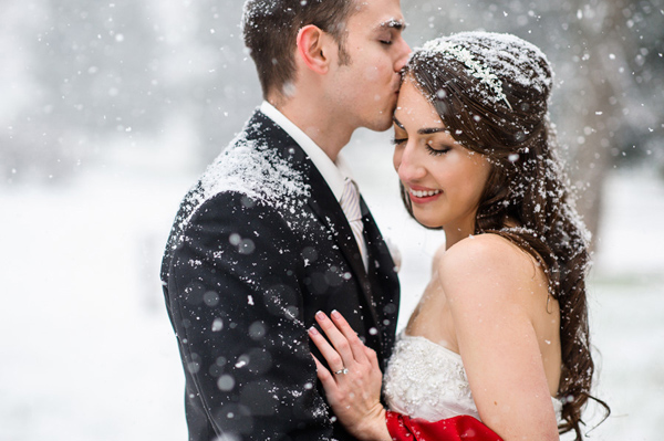 snowy wedding kiss, photo by Daniel Moyer | via junebugweddings.com