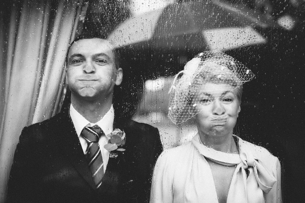 adorable bride and groom with faces smashed to glass, photo by Liam Crawley of CG Weddings by The Crawleys - England | via junebugweddings.com