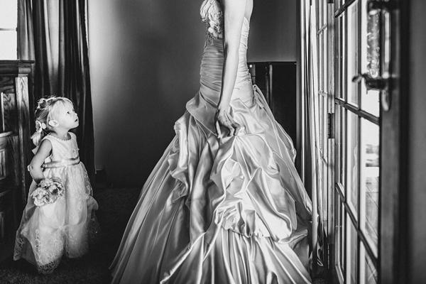 adorable photo of bride and flower girl by Gleason Photography - Nebraska wedding photographer   via junebugweddings.com