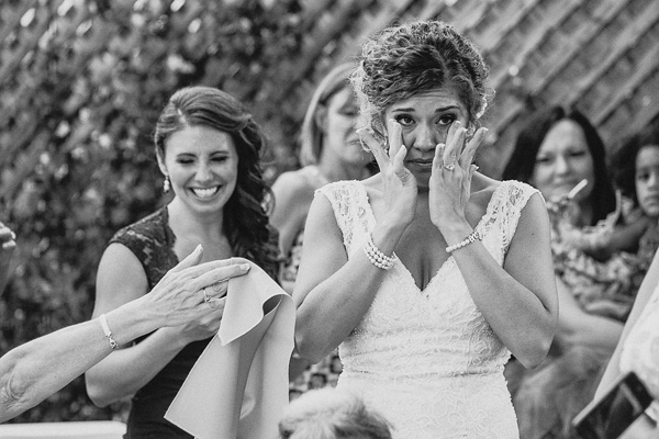 emotional bride at ceremony, photo by Heather Elizabeth Photography | via junebugweddings.com