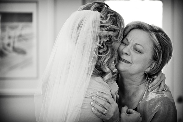 emotional moment between mom and bride, photo by Melissa Hopkins of Hopkins Studio | via junebugweddings.com