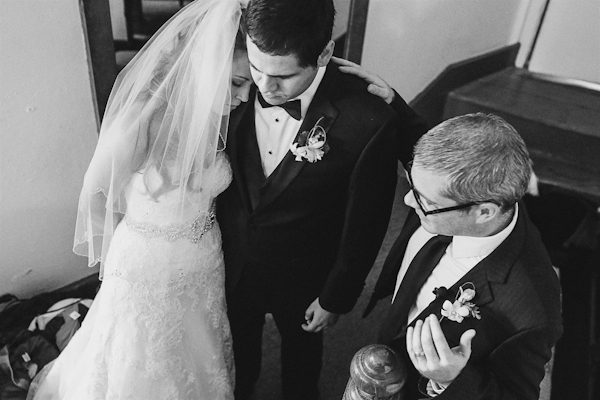 praying before ceremony, emotional wedding photo by Christina Carroll, Austin, Texas | via junebugweddings.com