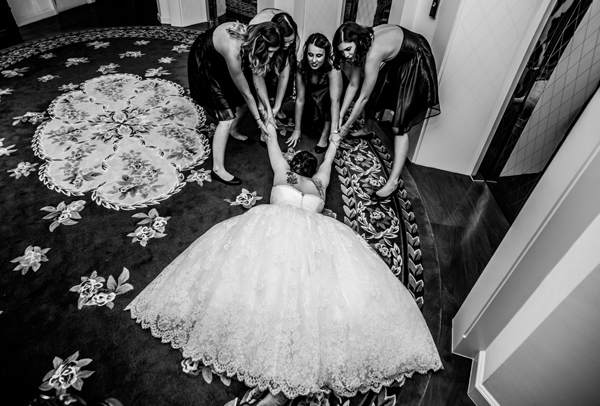 hilarious photo of bride being dragged by bridesmaids by Thailand wedding photographers Mott Visuals | via junebugweddings.com