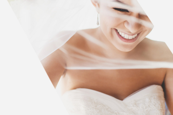 happy bridal portrait by Ross Harvey Photograpy | via junebugweddings.com