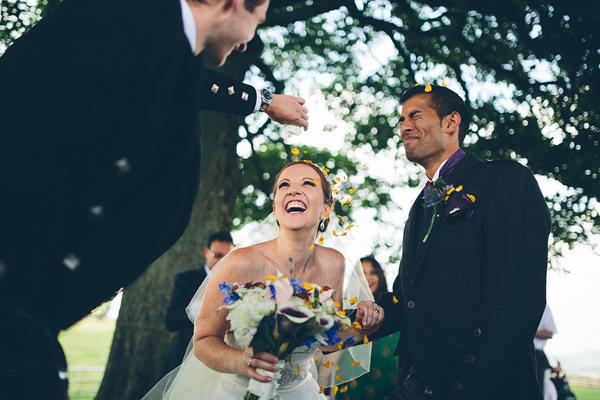 joyful wedding ceremony photo by Liam Crawley of CG Weddings by The Crawleys | via junebugweddings.com