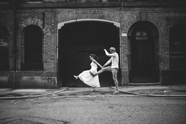 playful skipping bride and groom, wedding photo by Liam Crawley of CG Weddings by The Crawleys - England wedding photographers | via junebugweddings.com