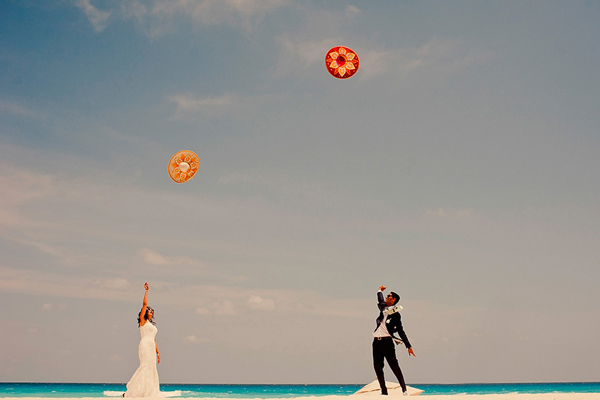 playful beach photo of Mexico destination wedding by Daniel Diaz Photography - Mexico wedding photographer | via junebugweddings.com