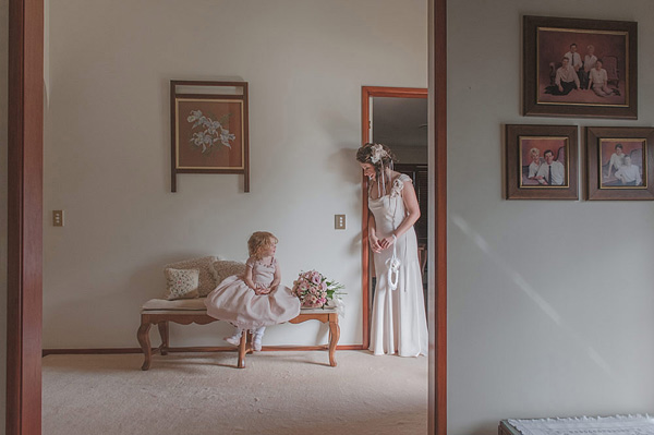 sweet wedding photo of flowergirl and bride by Studio Impressions - Australia | via junebugweddings.com