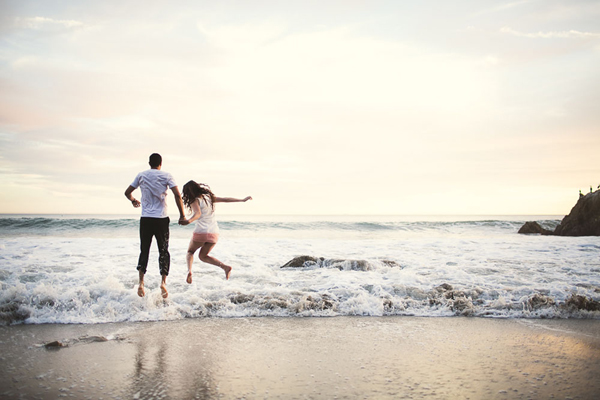 fun beach engagement photo by Ash Nayler Photography - Ontario wedding photographer | via junebugweddings.com
