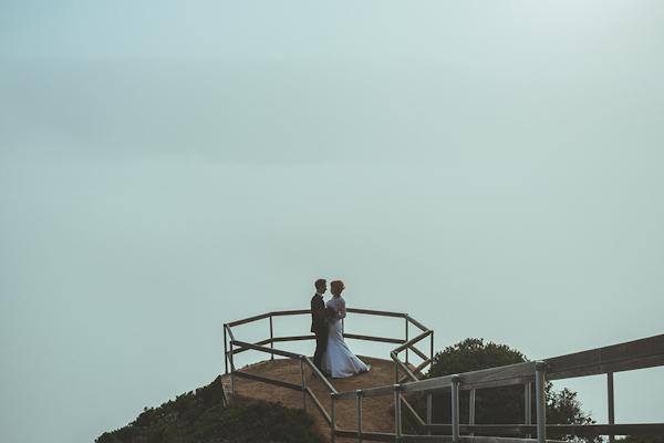 clifftop wedding portraits above Muir Beach, California from Kris Holland Photography | via junebugweddings.com