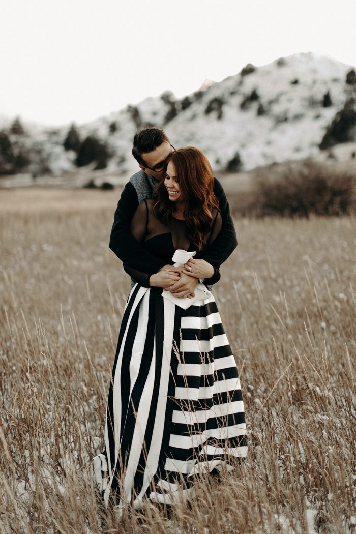 couple embracing with striped skirt