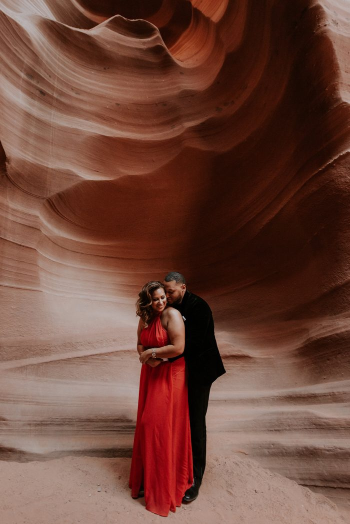 engaged couple posing in a cave