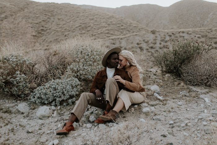 couple sitting in the desert