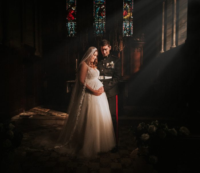 bride and groom with stained glass