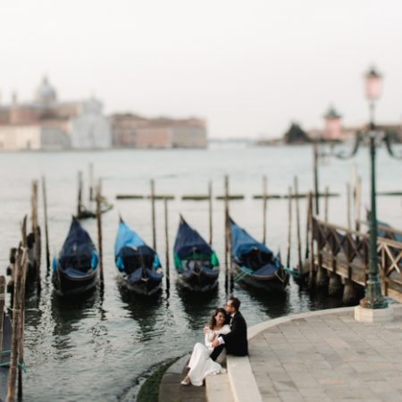 couple outdoors with boats