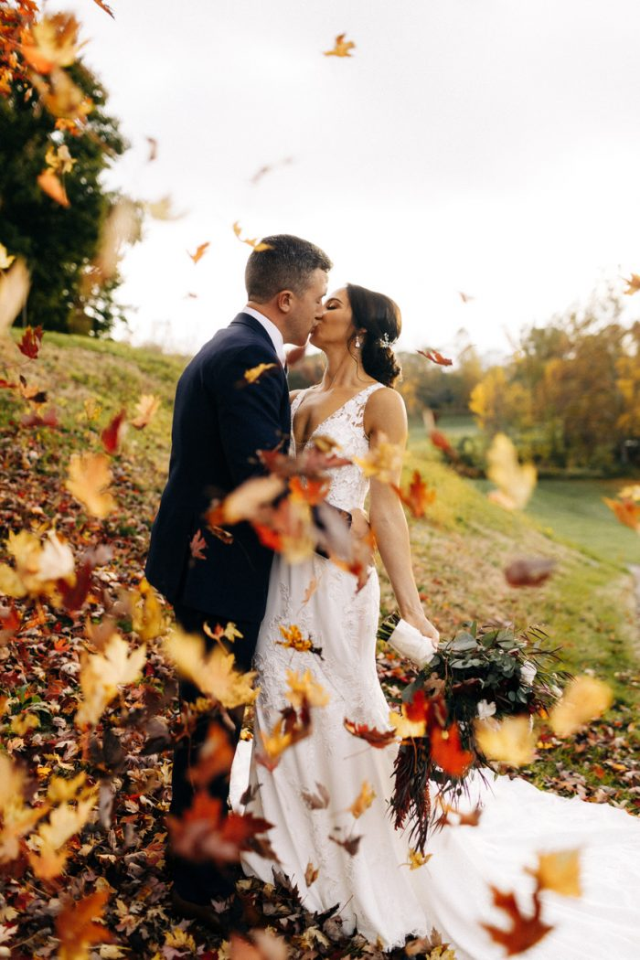 windy leaves with couple