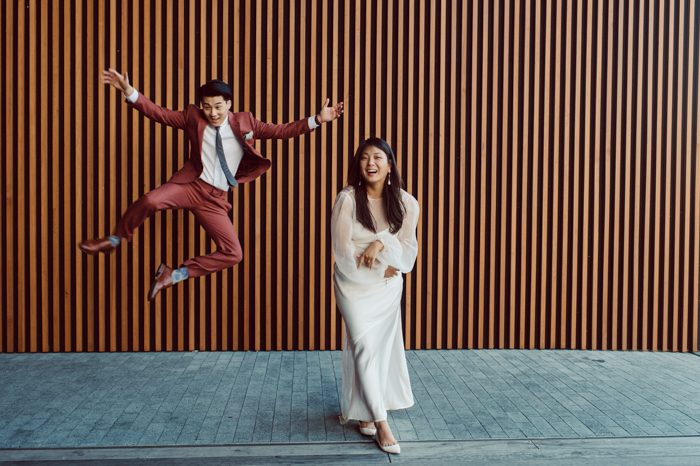 asian wedding portrait happy jumping