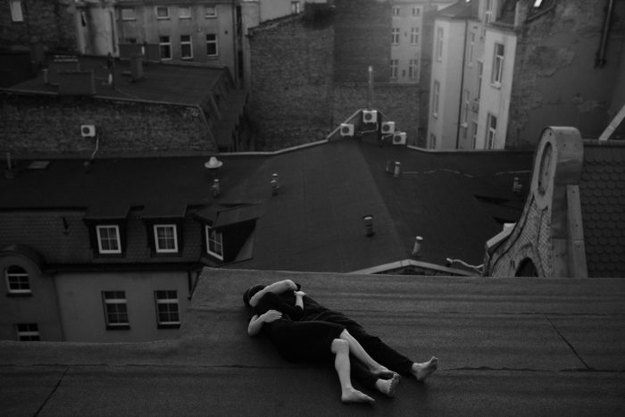 black and white rooftop embrace