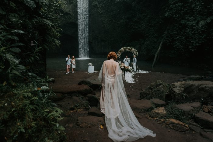 wedding ceremony by tropical waterfall