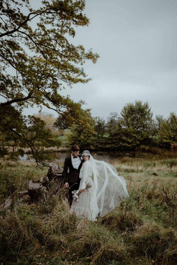 bride and groom in Scotland field