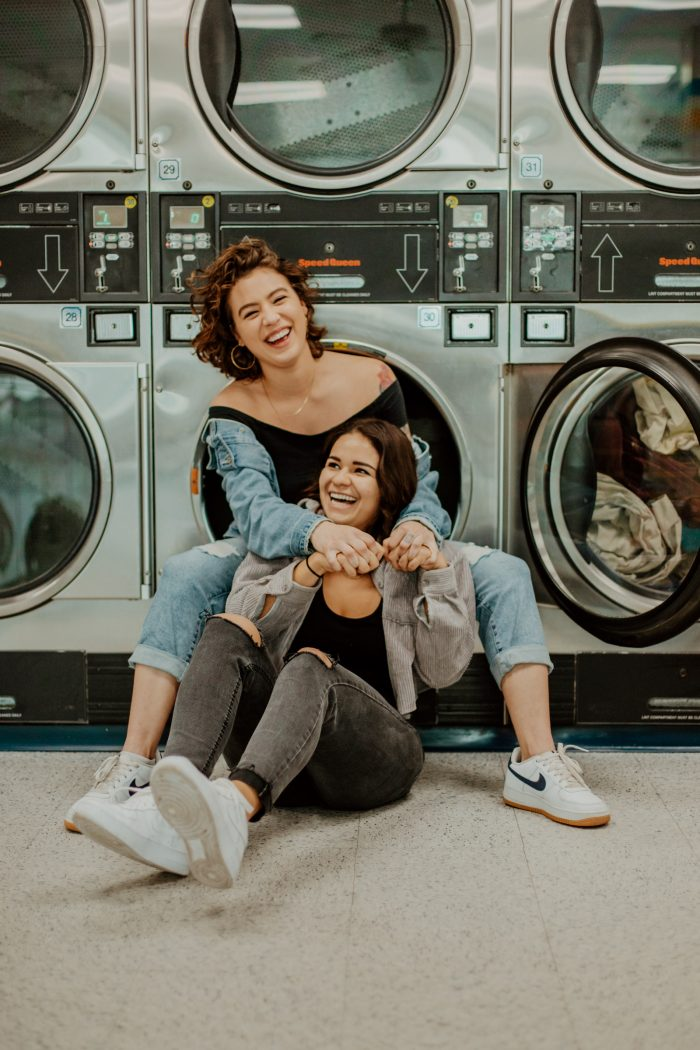 joyful laundromat couple portrait