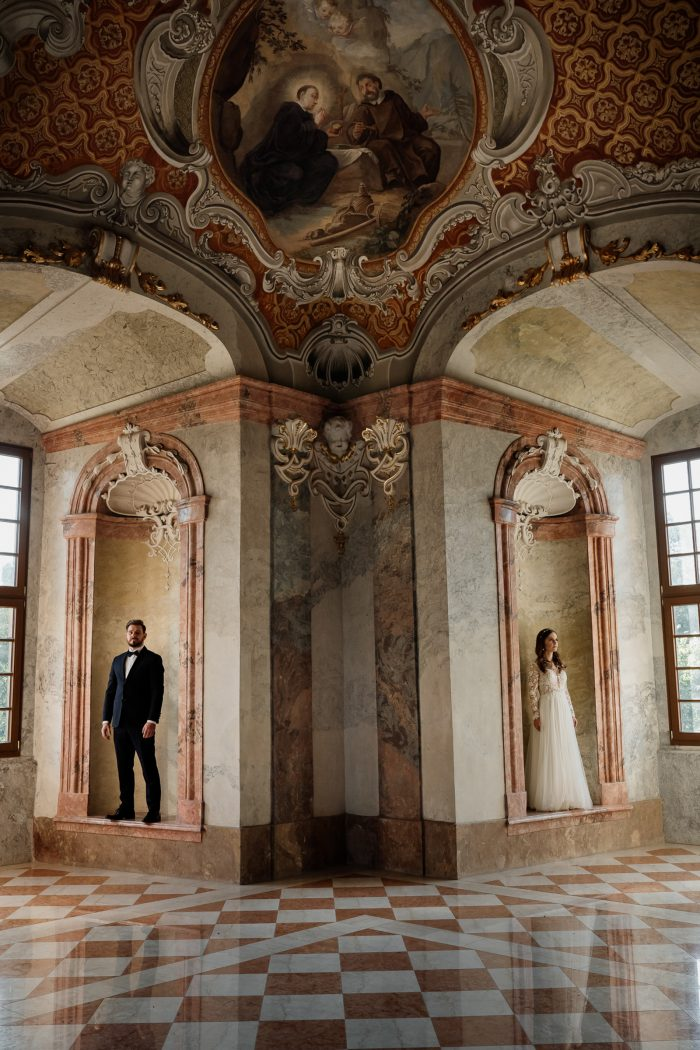 extravagant building couple posed as art