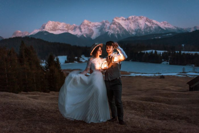 wedding portrait in mountains with lanterns