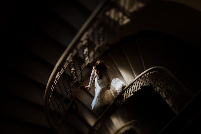 elegant bride descends staircase in Top Pic of month