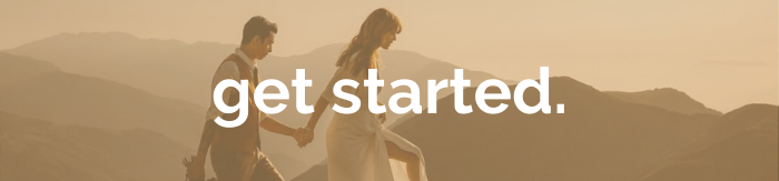 couple climbing in mountains with get started text overlay