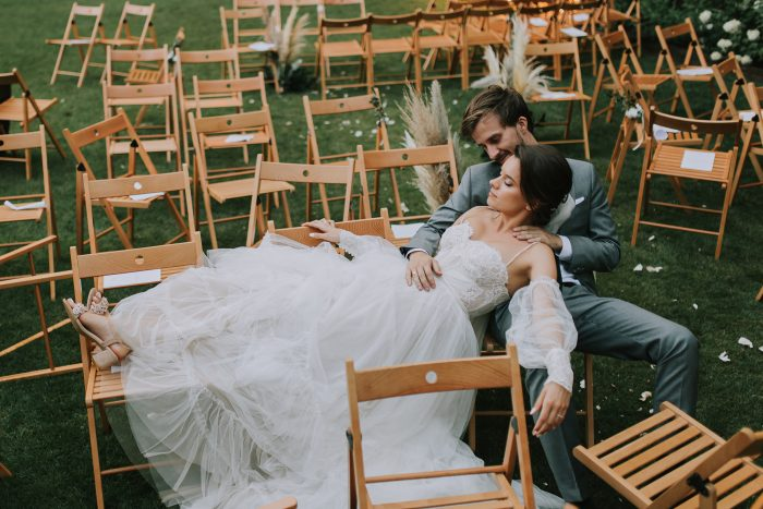 lounging married couple among guest chairs