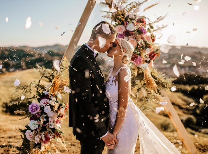 flowers falling around just married couple