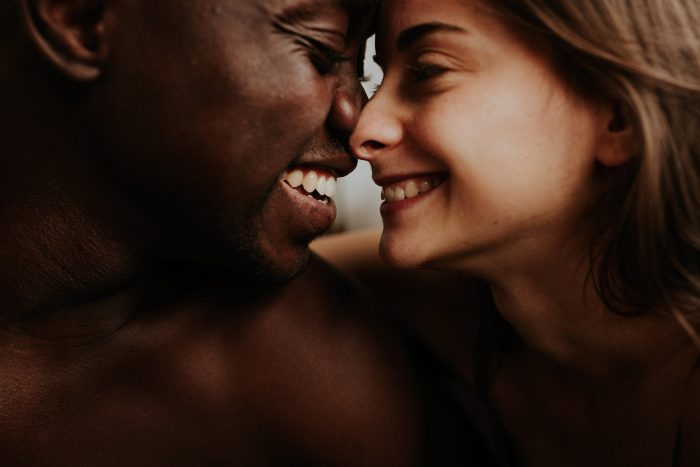 close up intimate, happy portrait of couple