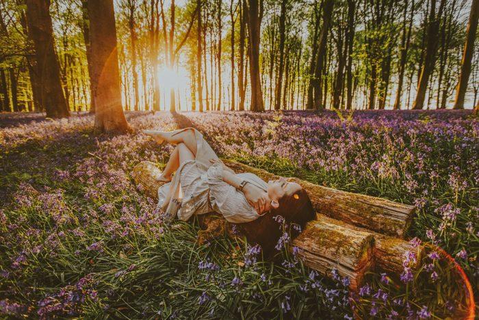 girl laying in flower field