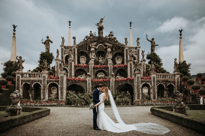 couple portrait in front of intricate architecture