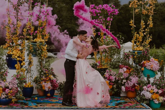 colorful florals and pink smoke for wedding