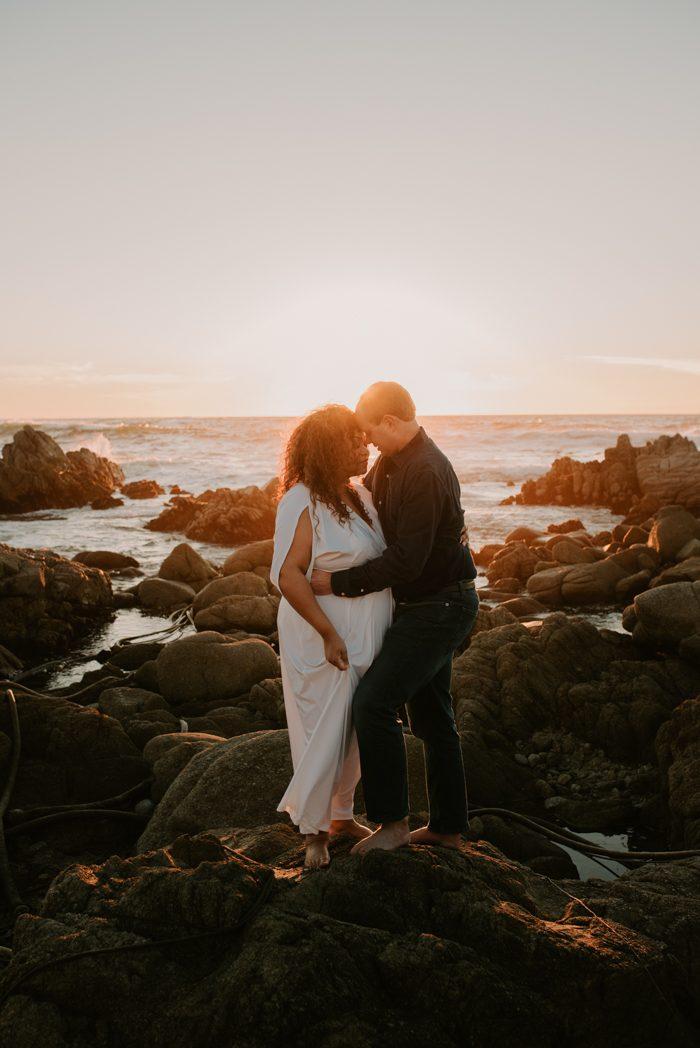 diverse couple standing near seaside