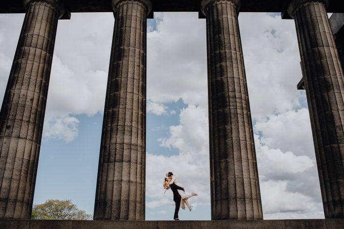 wide shot couple among large columns