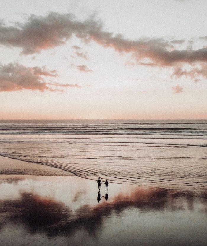 New Zealand sunset couple reflection