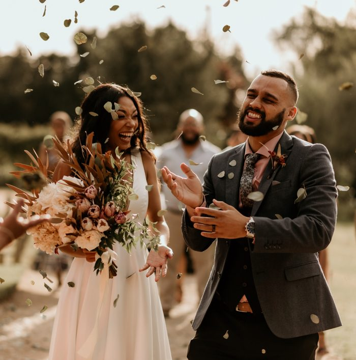wedding couple with flower petals