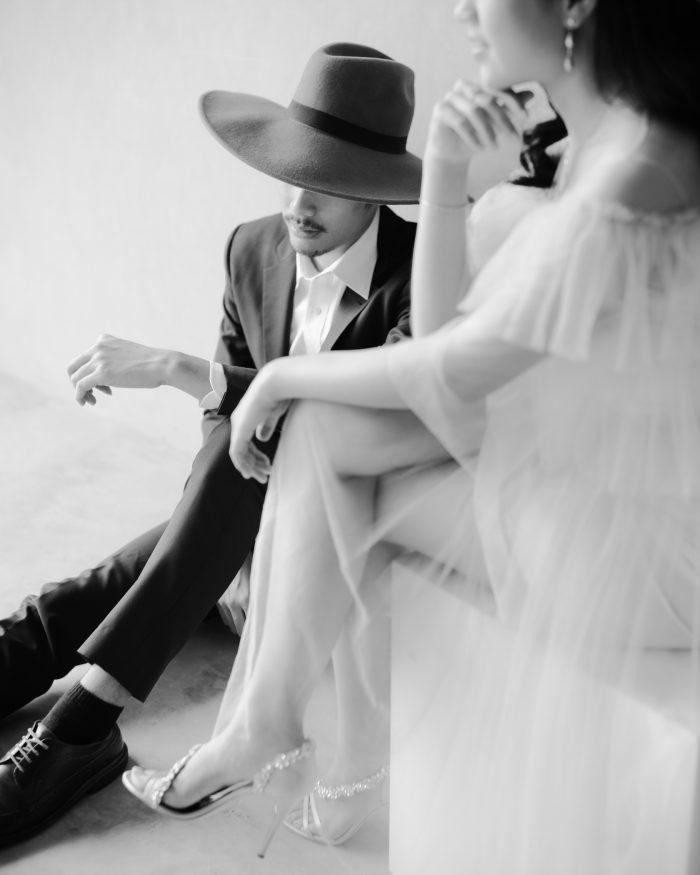 stylish couple, groom in hat