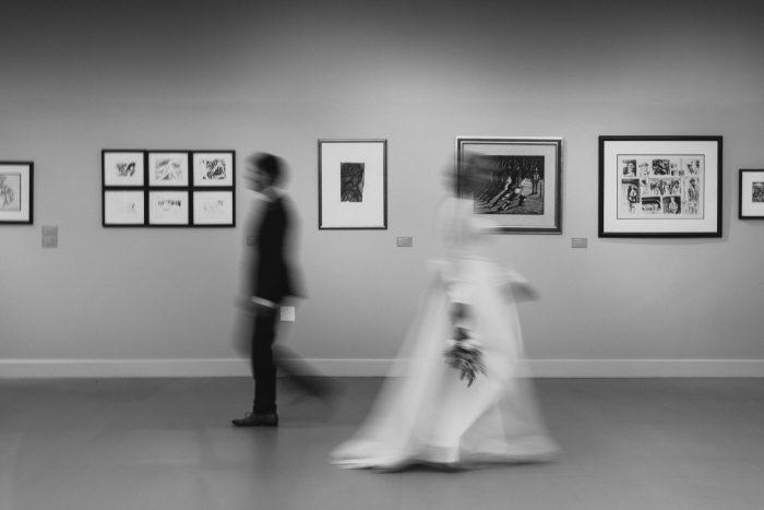 intentional blur wedding photo in art museum