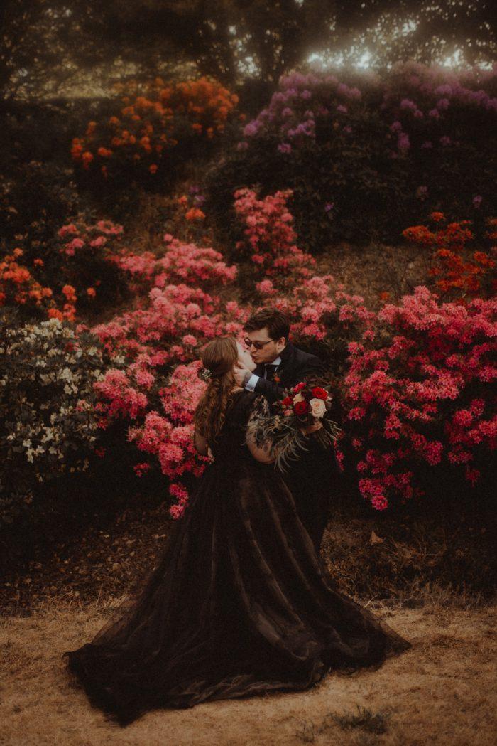 black wedding gown couple portrait