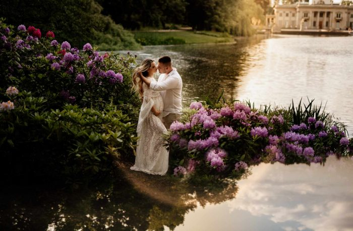 maternity couple photo on lake with flowers