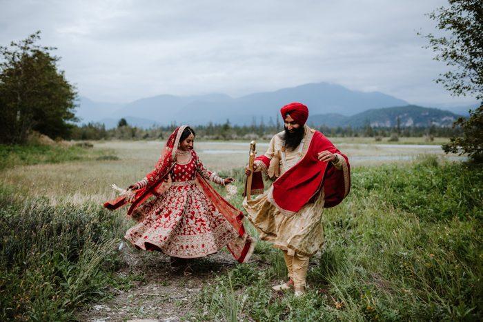 couple running through a field