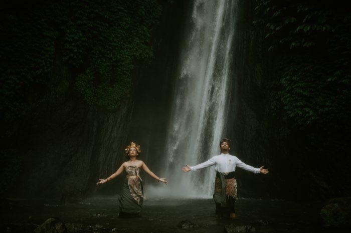 wedding couple under waterfall
