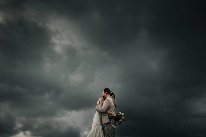 couple embracing in a storm